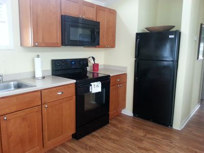 A new kitchen with full size appliances.