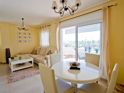 Photo for Great views over pools, golf course, lake & mountains from sunny balcony