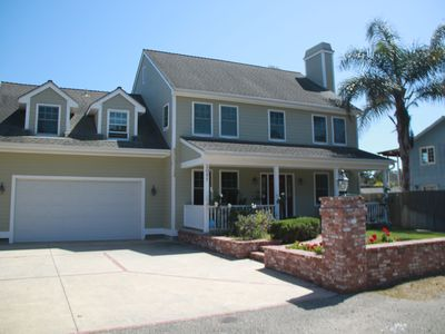 Photo for Spacious newer home within walking distance of secluded beaches and polo fields.