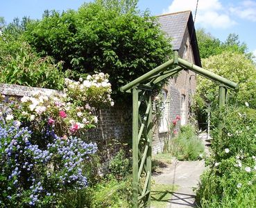 Photo for Pretty period cottage with garden, within easy reach of all Dorset and the coast