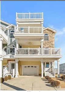 Photo for Just Listed!  Beach block, beautiful 5 bedroom luxury townhouse.  Steps to the.