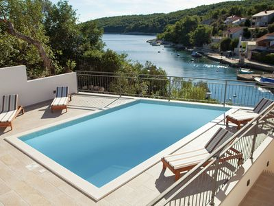Photo for Seaside villa with private pool and beautiful view across the bay