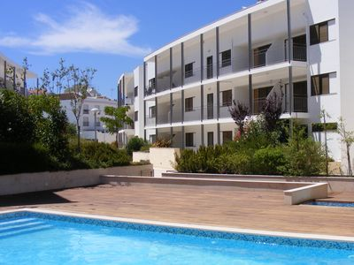 Photo for Modern apartment with communal swimming pool in the center of Tavira with garage
