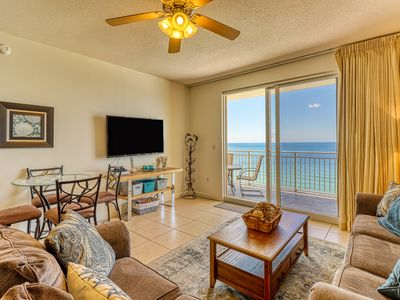 Photo for Well-stocked condominium w/ full kitchen & access to beach + amenities