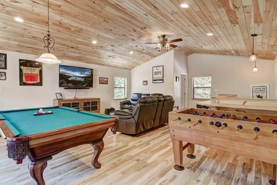 Game room with foosball table & pool table