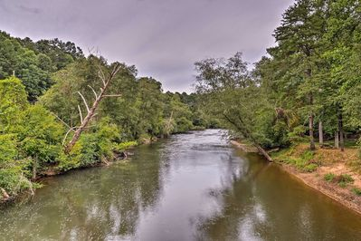 This Ellijay vacation rental cabin sits across the street from Cartecay River.