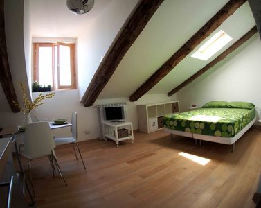 Photo for A cozy bohemian nest on the roofs in the center of Turin