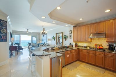 open concept and spacious kitchen with granite and stainless appliances.