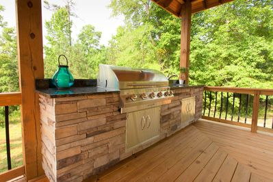 Built in outdoor kitchen with grill and sink