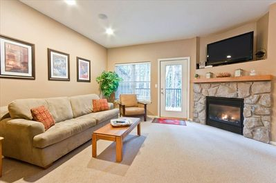 Living Room with Rock Fireplace, & Full Size Sofa Pull-Out