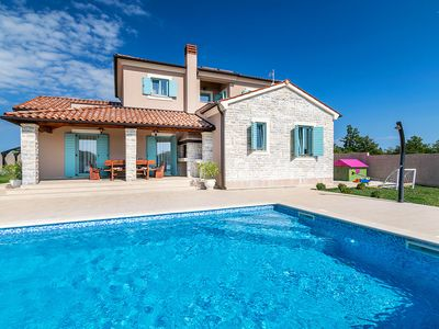 Photo for Modern villa with private pool, table football, table tennis, playground, climate, WiFi, sun loungers and barbecue area