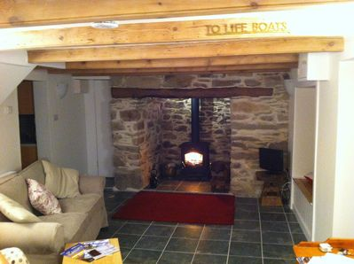 Magnificent  Inglenook fireplace with log burner and bread oven. Beamed ceilings