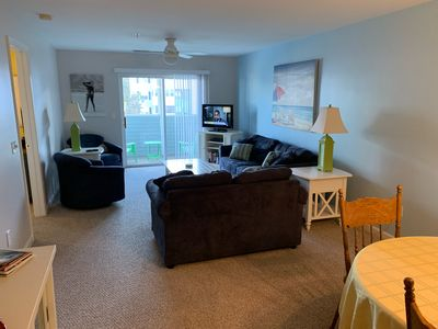 Spacious living room with sleeper sofa, TV, expanded cable, DVD player & porch