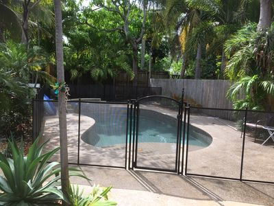 Photo for Tropical Heated Pool home in fun beach side town  Sleeps 8 Private