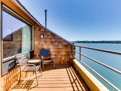 Photo for Waterfront condo w/ shared pool/hot tub, private deck, & exquisite views