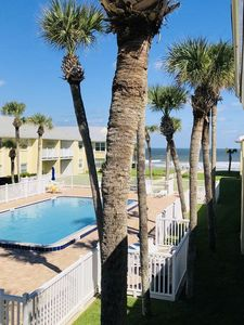 View of the the ocean and the pool from the balcony