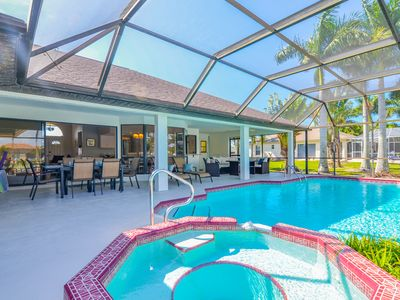 Photo for 3/2 updated Gulf access canal home electric heated pool & Jacuzzi - Coconut Cove