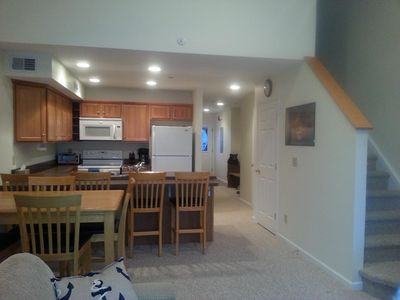 Living and eating area. Comfortable seating for eight. Enjoy family and friends!