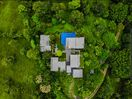View of property shot by drone 2019. Multiple structures comprise the house.