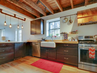 Photo for Open, airy condo w/ private deck - steps to the Old Port, restaurants & ferries!