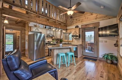 This 1-bedroom, 2-bath cabin was custom built with handcrafted wood.