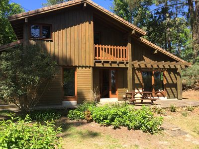 Photo for Charming wooden house, on the lake, quiet not overlooked, 5 minutes from the ocean