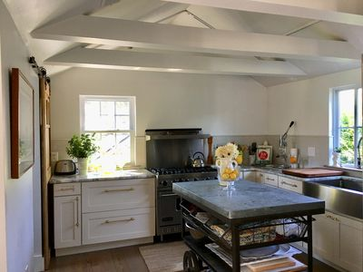 Chef's kitchen with a professional 6 burner stove and kitchen necessities