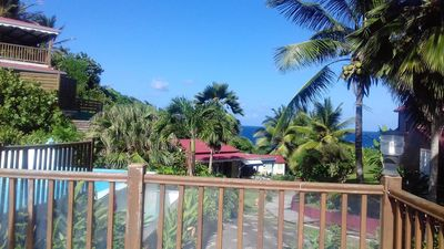 Photo for Homerez last minute deal - Nice bungalow with pool access