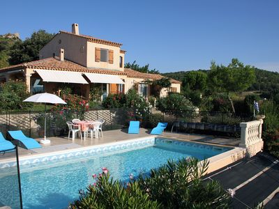 Photo for In a farmhouse with pool on the upland of a Provencal village