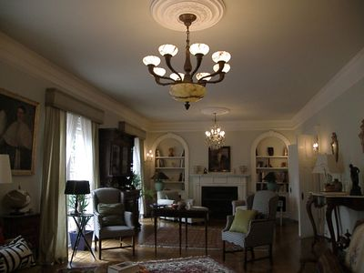 living room with antique furniture, paintings, and chandeliers from Sicily