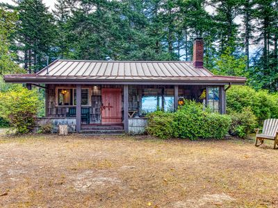 Photo for NEW LISTING! Beautifully restored lakefront cabin on five acres!