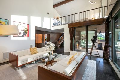 Living Room - Welcome to Los Angeles! Your gated property blends mid-century architecture seamlessly with modern amenities.
