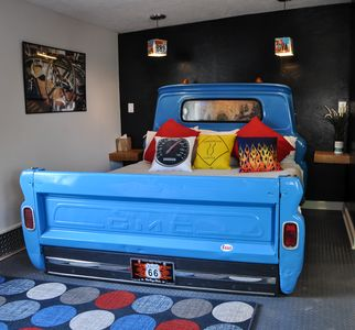 Yes, it is a real and literal, 1963 GMC pick-up truck bed!