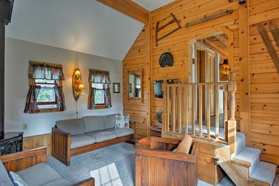 The spacious interior of this home features wooden accents and rustic decor.