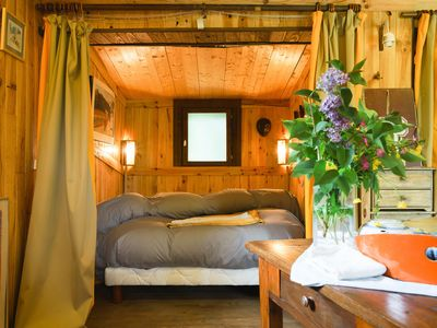 Photo for Atypical wooden chalet, surrounded by greenery, quiet, birds you rev