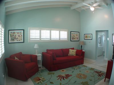 Newly remodeled living room with a high quality slipcovered sofa sleeper.