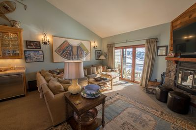Living room and deck with views of Mt. Crested Butte