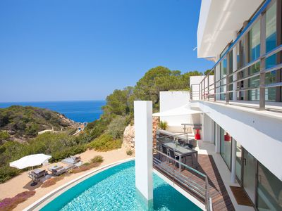 Photo for Design villa with infinity pool overlooking the beach and chill out