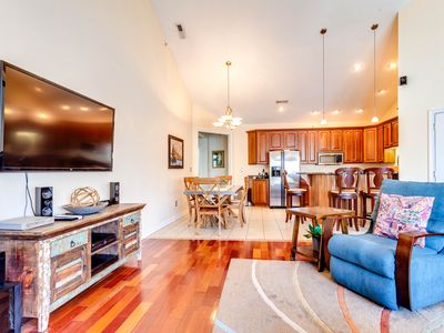 Photo for Luxury lakeview condo with covered balcony, shared pool & hot tub