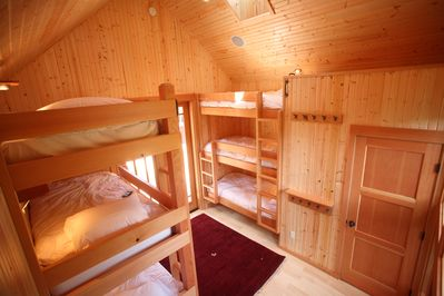 Bunkhouse with 6 bunks and a bathroom. I great place for all the kids to sleep!