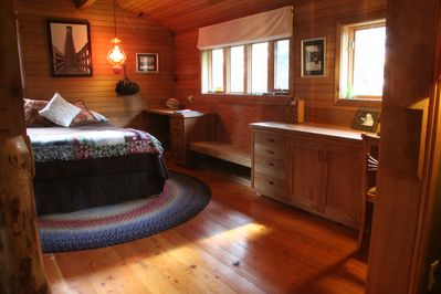 master bedroom with built-ins and a window seat