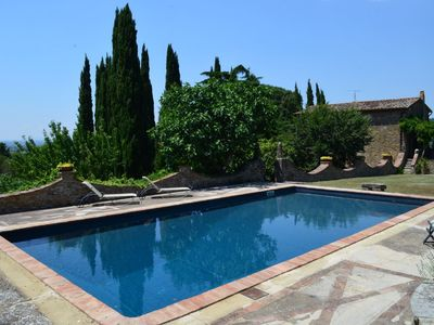Photo for Old stone house with pool and views on the Cortona fortress