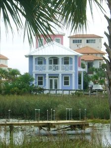 Facing private Oyster Lake and single tier of ocean front homes to the Gulf