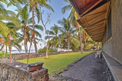 This 2-bedroom, 2-bath vacation rental house rests on the secluded Ke'ei Beach.