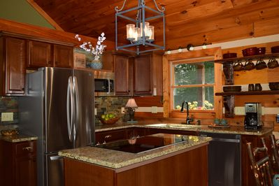 Fully equipped kitchen with all new stainless steel appliances and granite.