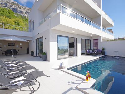 Photo for Modern holiday house Anja with heated pool and sea view, 3 bedrooms 6+2 pers.