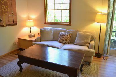 New high-end linen couch, large hardwood coffee table