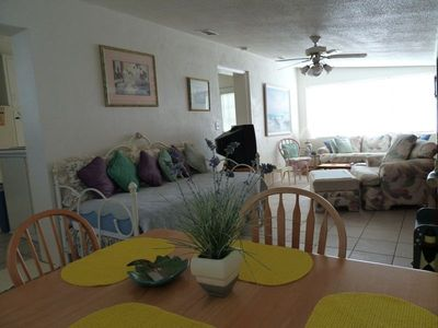 Family Room with a Day Bed for additional guest is located next to dining room.