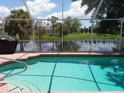 Photo for Serene Home On Saltwater Canal, Heated pool..  Short Ride to Blue Water Beaches!