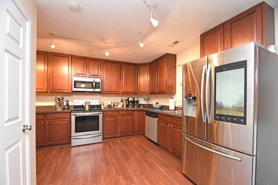 Kings Manor features a modern open kitchen with the latest appliances.